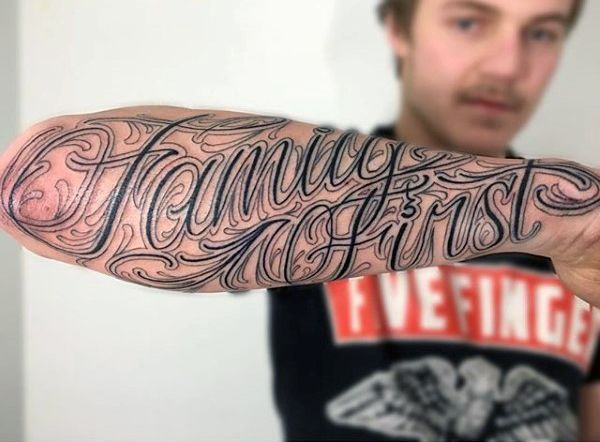 Devoted Male With Family First Tattoo On Forearms