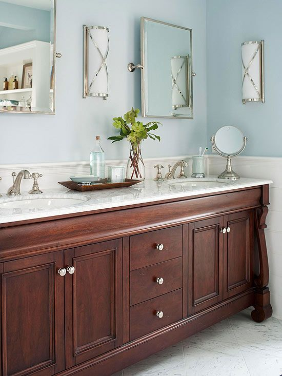 Powder Blue + White + Walnut In this bathroom, white beaded board and soft blue walls lend a barely-there backdrop for a rich walnut vanity and shimmering chrome furnishings. The walnut cabinet base helps the otherwise-airy color palette feel grounded. The bathroom's chrome furnishings reflect and bounce light around the room to add subtle sparkle.
