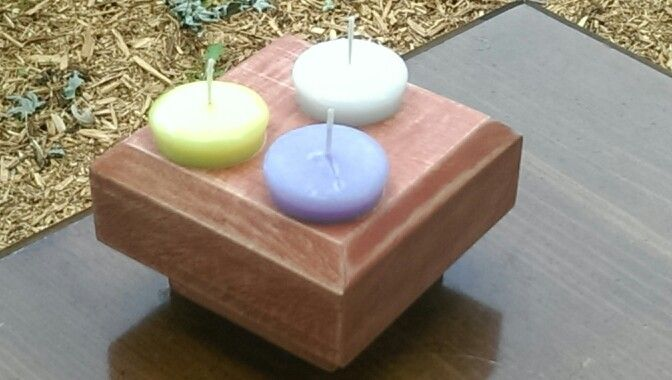 This is a curly maple candle holder that fits votive candles.  It has a redwood stain.