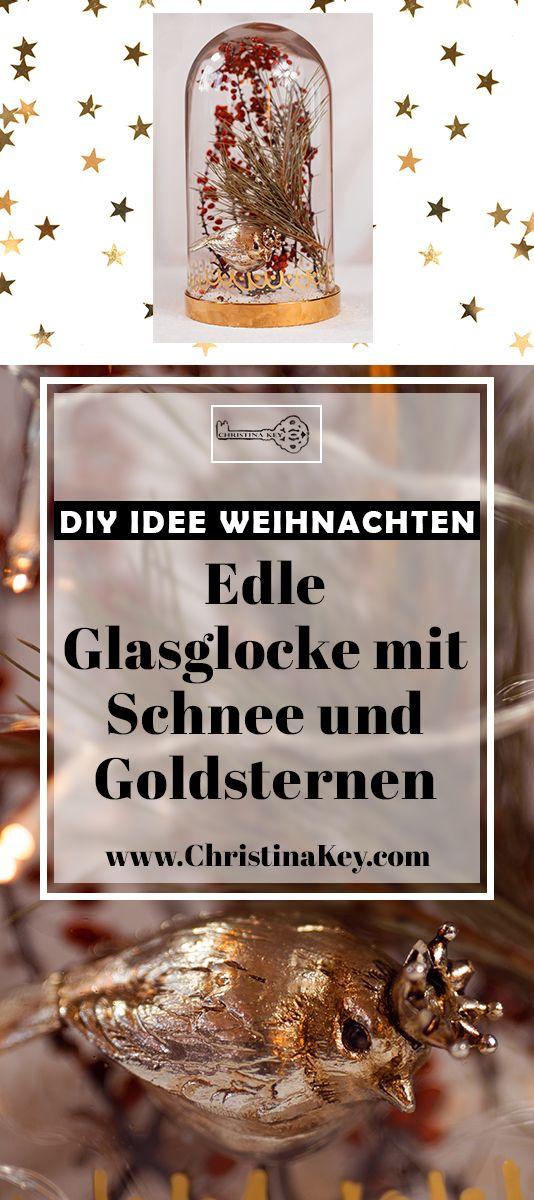 Edle Low Budget DIY Deko Idee für Weihnachten - Hübsche Glasglocke mit Schnee, Goldsternen und roten Beeren - Das stimmungsvollste Do It Yourself Projekt der Saison! Jetzt entdecken auf CHRISTINA KEY - dem Fotografie, Blogger Tipps, Rezepte, Mode und DIY Blog aus Berlin, Deutschland