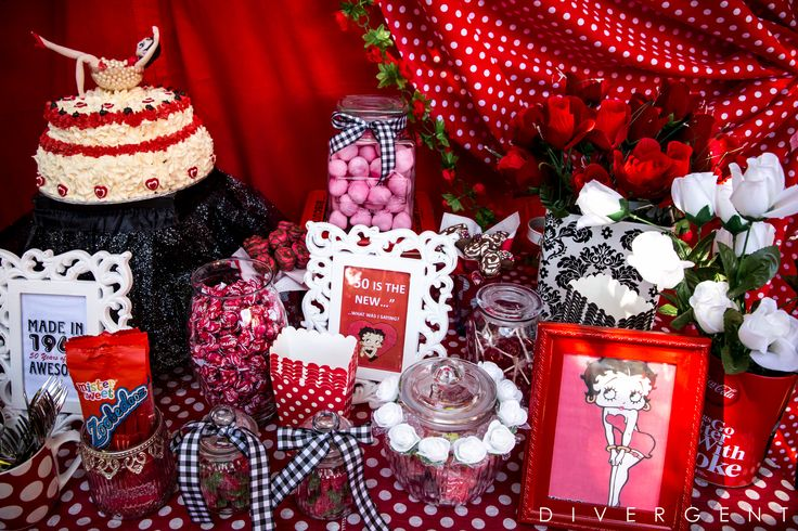 Red, Black and White themed garden birthday party candy buffet table with Betty Boop decor accents