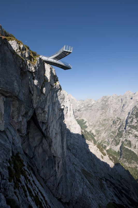 "At the base of Alpspitze peak, visitors will find the AlpspiX Viewing Platform hovering 13 meters (42 feet) over an empty void in the shape of an 'X' with two protruding platforms. The ex- ceptional architecture opens un-matched views towards Zugspitze peak & the Höllental gorge lets visitors experience a spectacular alpine high. The Summit Adventure Trail & the Pleasure Adventure Trail also promises excitement along with curious & interesting ""peak experiences""."