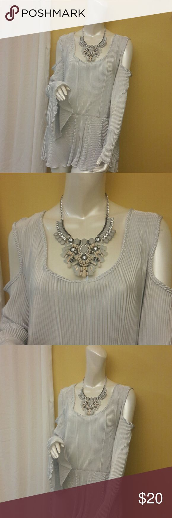 PLUS SIZE Silver Blouse Brilliant silver cold shoulder top!!! Stunning when  paired with a skirt or jeans. 100% polyester. Ashley Stewart Tops Blouses