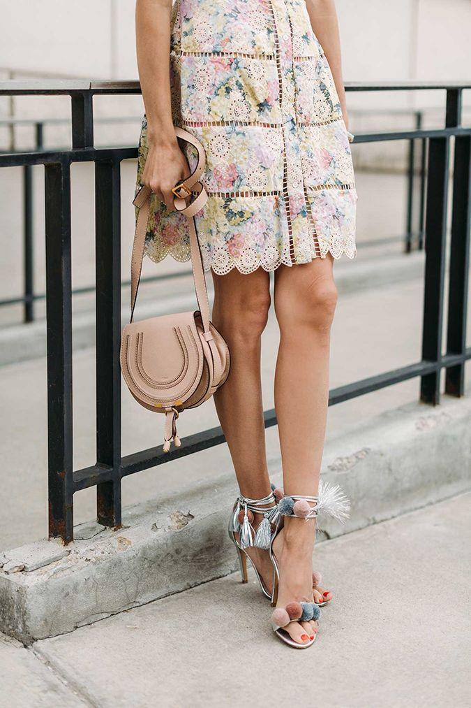 feminine floral dress and pom pom heels