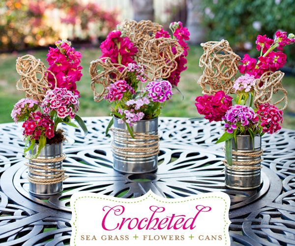 Soup cans turned into vases/centerpieces. Cute, cheap, kind of rustic with the string. http://www.hostessblog.com/2011/05/floral-diy-with-sea-grass-soup-cans/