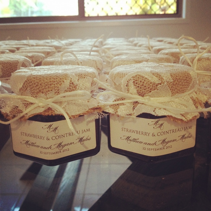 Wedding favours - strawberry and cointreau jam in jars with hessian and lace wrapping