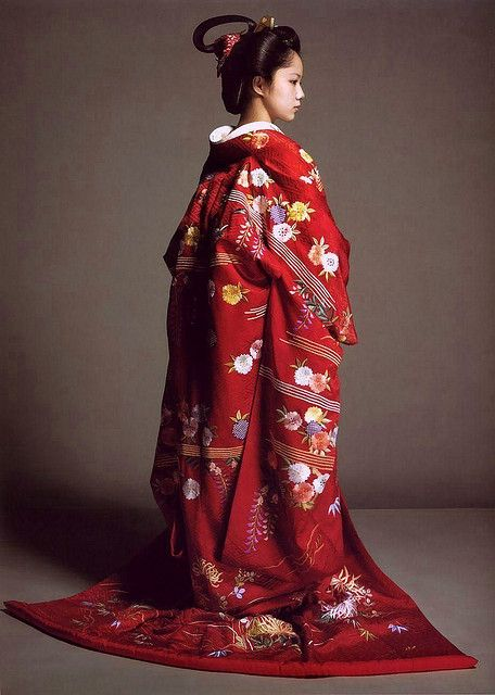 Kimono, traditional Japanese garments, are T-shaped, straight-lined robes worn so that the hem falls to the ankle, with attached collars and long, wide sleeves. Though most often worn by women , Kimonos can also be worn by men and children. Kimonos are used more often for special occasions, and less on a daily basis.