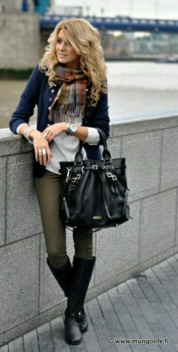 Black military jacket + tartan scarf + olive pants + tall black boots.