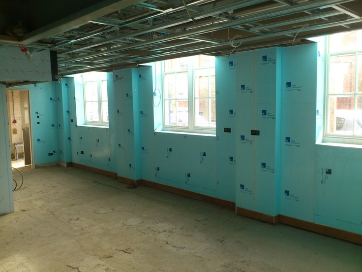 Altro Whiterock wall cladding during installation by Whiterock Interiors at Sunnyhill Primary School, London. Note the ceiling grid ready to receive the Altro washable panel system.