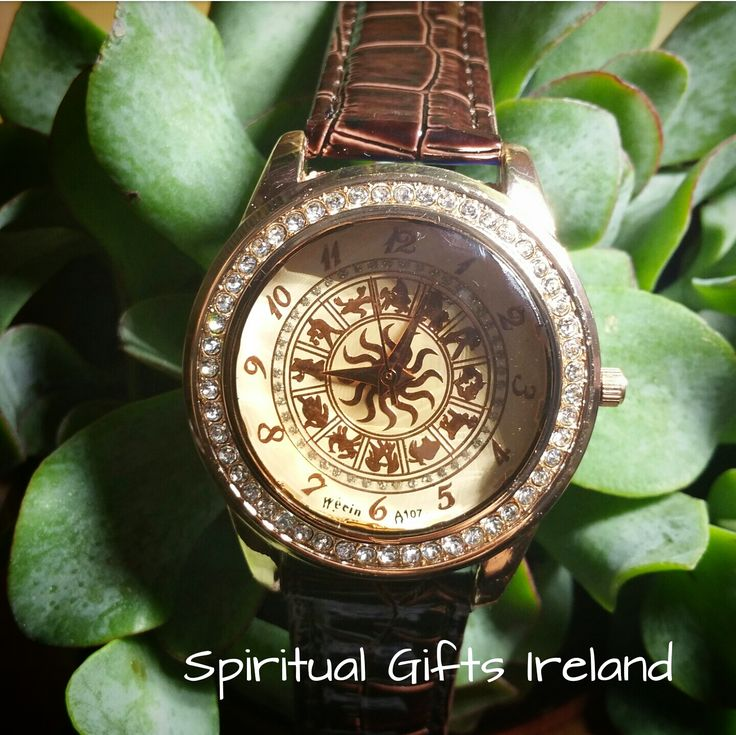 ♈ ♉ ♊ ♋ ♌ ♍ ♎ ♏ ♐ ♑ ♒ ♓ This watch, with its unique combination puts the 12 signs of the western zodiac on your wrist.  A perfect accessory for astrology lovers.  Each watch features a faceted glass convex face, cream background and a golden sun in the centre of the gold zodiac symbols.  The strap is coffee coloured faux leather with clear diamonds on a rose gold face.♈ ♉ ♊ ♋ ♌ ♍ ♎ ♏ ♐ ♑ ♒ ♓  Watch length: 235mm  Gift bag included