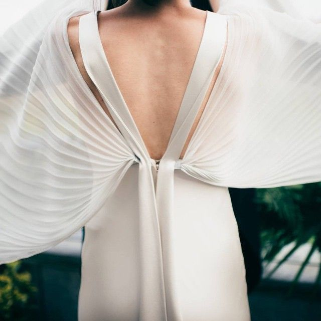 this catch of this winged - WINGED  - dress ...  we'll love it forever @lisadevinephotography ..  FOR. EVER   (i hope this bride knows she absolutely smashed it with that one huh ) • • • • • #wearetheweddingcollective #modernwedding #wingeddress #bridalstyle #modernbride #creativehappenings #indiebride #thevisualscollective #creativebride #weddingtrends #postthepeople #freedomthinkers #visualsgang #radlovestories #bohobride #weddinginspiration  #postitforaesthetic #muse #bridalinspo