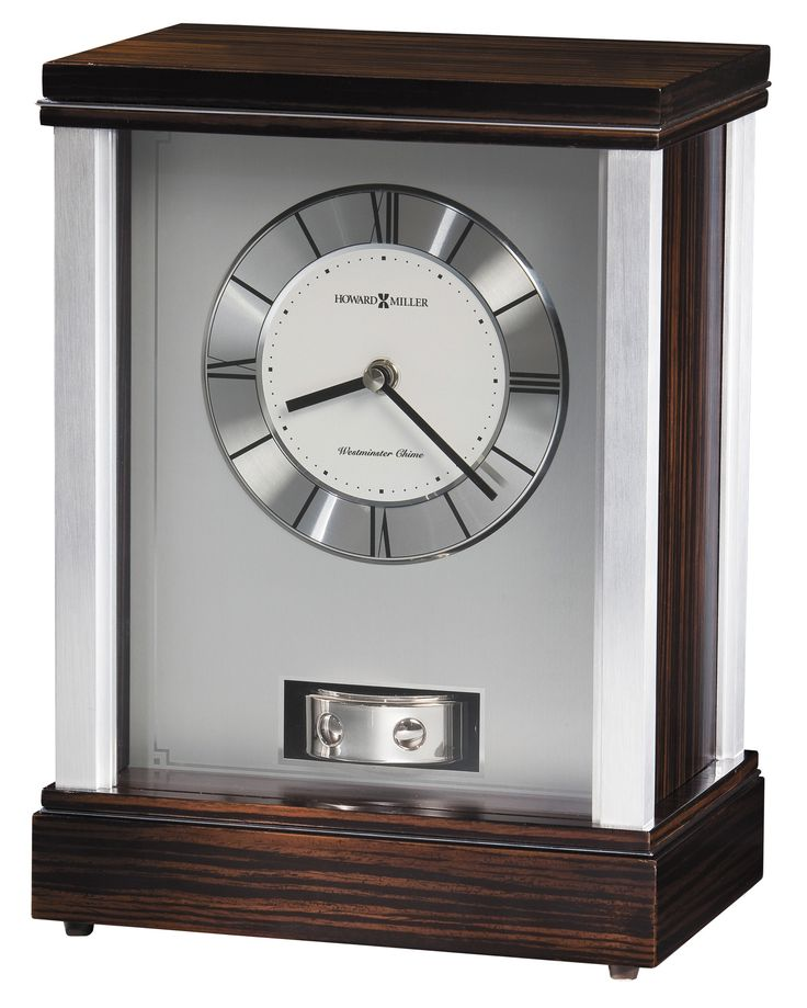 Gardner Clock. This sleek modern contemporary mantel clock will be perfect for your home that is full of silver decor. Quartz, battery-operated movement plays Westminster chimes on the hour and features volume control. Requires two AA and two C sized batteries