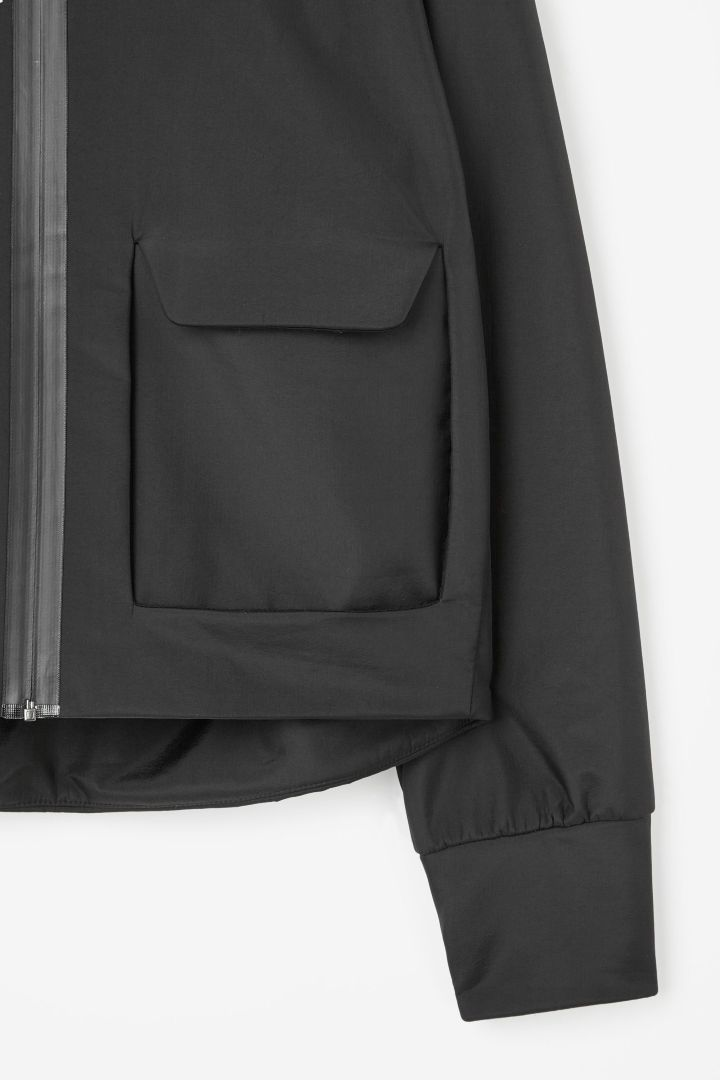 Technical cropped jacket