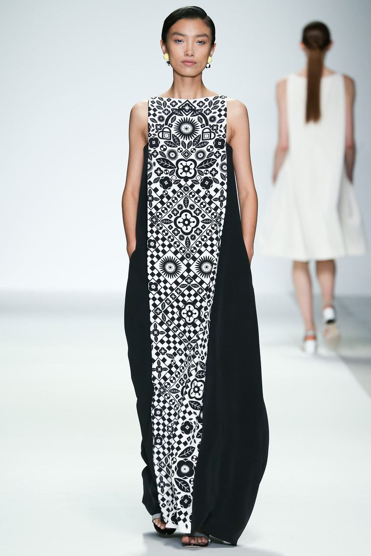 Designer - Holly Fulton Monochrome styled maxi dress/ floral embellishment all along the middle/ slightly panelled