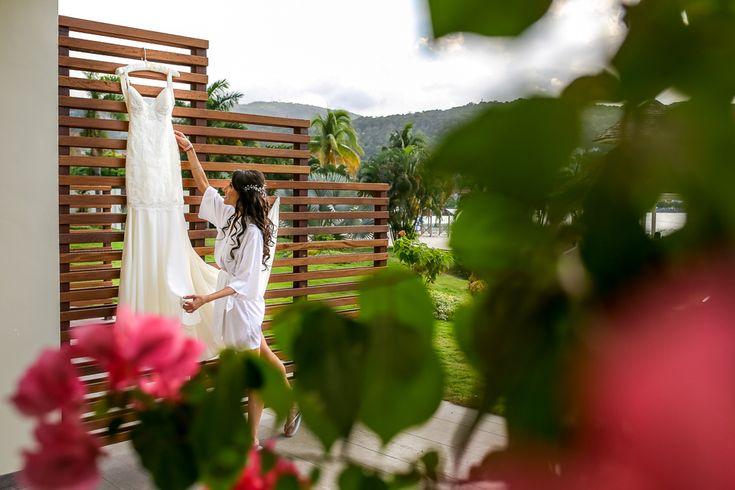Bride getting ready to put on the dress at Moon Palace Jamaica Grande #destinationwedding