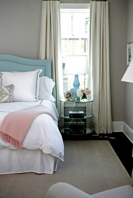 girl's rooms - cool gray walls baby blue velvet camelback button tufted headboard silver nailhead trim baby blue double gourd lamp mirrored brass round table nightstand white duvet shams navy blue stitching pink cashmere throw