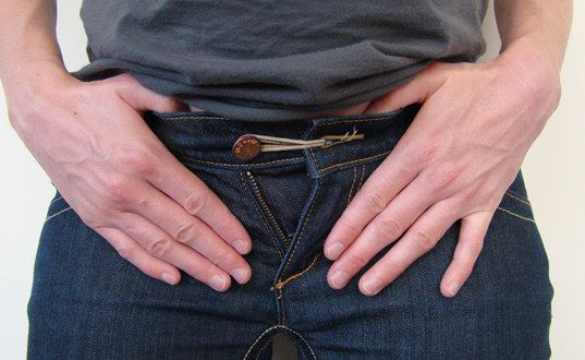 Extend your waistline by adding a rubber band to your button. | 21 Hacks Everyone Who Wears Clothes Should Know