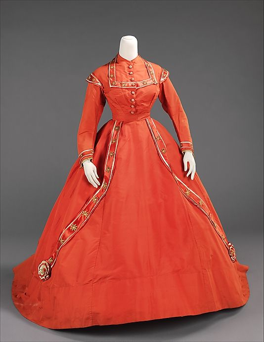 Afternoon dress ca. 1865, American (silk,metal) The influence that military uniforms played on women's dress during the years of the Civil War is evident here.  Women reflected their patriotism readily in their mode of dress to help encourage the soldiers on to victory.  The bands ending in rosettes on the skirt are reminiscent of swags and decorations at military ceremonies while the shoulder and sleeve decorations are taken from stripes and epaulets on military jackets.