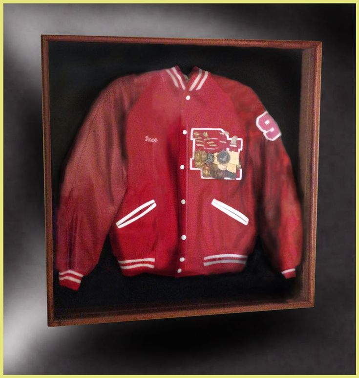 over master bed letter jacket shadow box