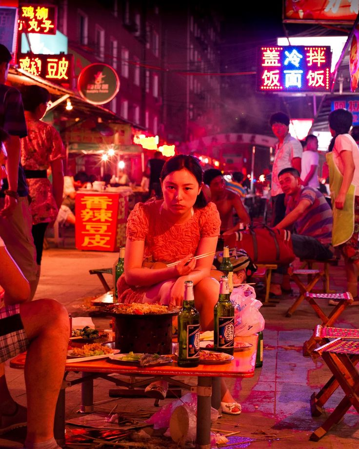 While I usually like to see tight composition and graphic elements in photographs, this example of red - which is clearly focused on the lady - beautifully captures the atmosphere of a single moment on a hot summer night in a Chinese street market.