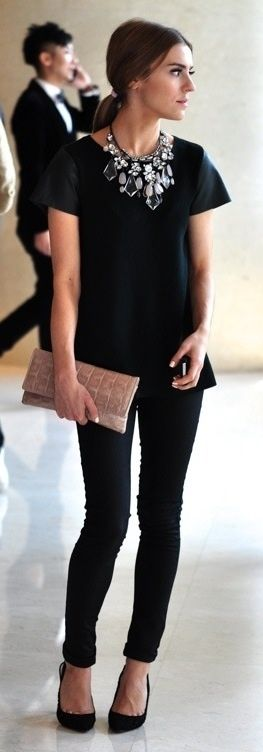 All black with statement necklace. Love ankle length black pants.