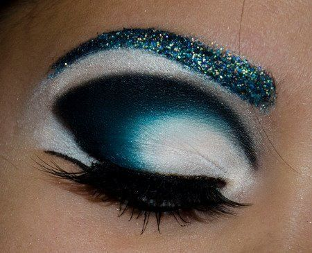 over the top blue eyeshadow with glitter and heavy shading...absolutely gorgeous