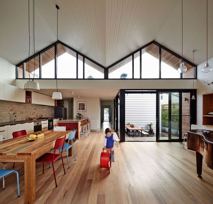 What appears to be a common home from the street is actually a modern family home connecting to the outdoors. An M-shaped roofline shelters a fresh design.