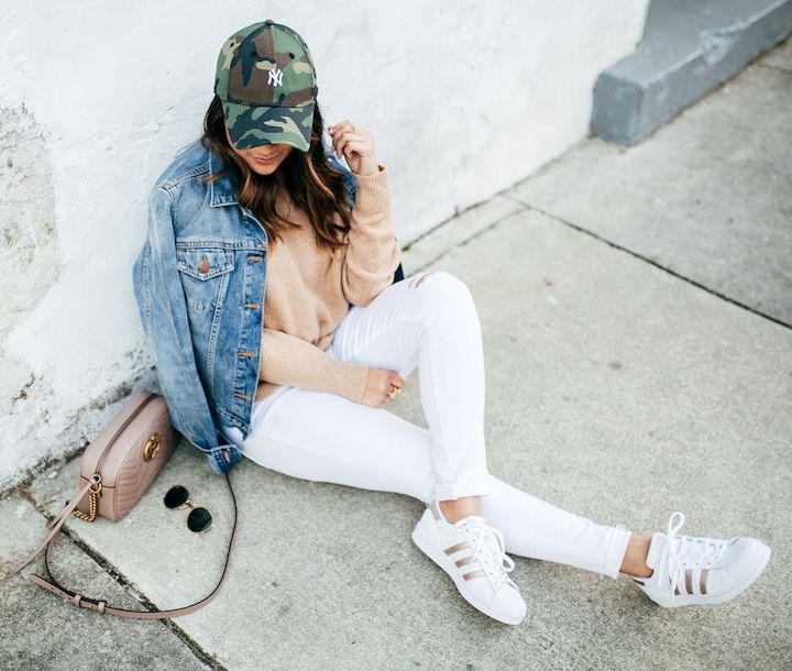 haute off the rack, women's fashion, white jeans, denim jacket, spring style, camo hat, camel sweater, adidas superstar shoes, rose gold sneakers, gg marmont matelasse shoulder bag, everyday style