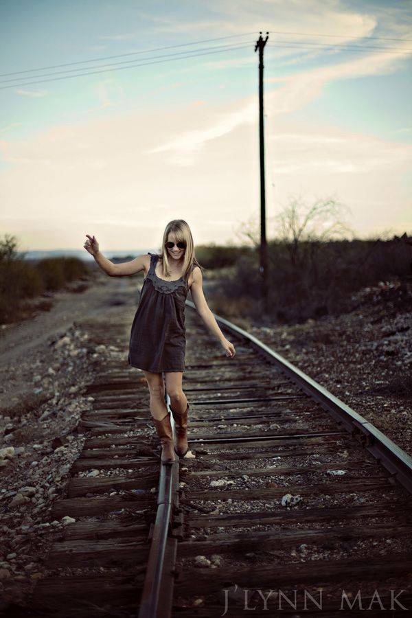 senior picture ideas at railroad tracks | high school senior portrait | Senior posing on a railroad track:
