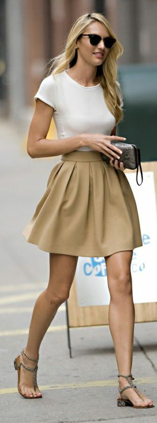 Candice Swanepoel in a tan skater skirt & white tee