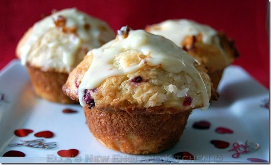 Raspberry-lime-coconut muffins with white chocolate glaze.