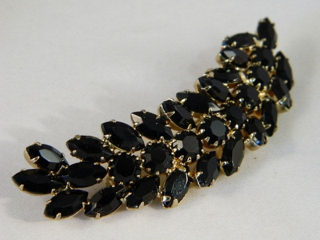 Black Rhinestone Feather Brooch / Black Rhinestones / Black and Gold Pin by VintageBaublesnBits on Etsy
