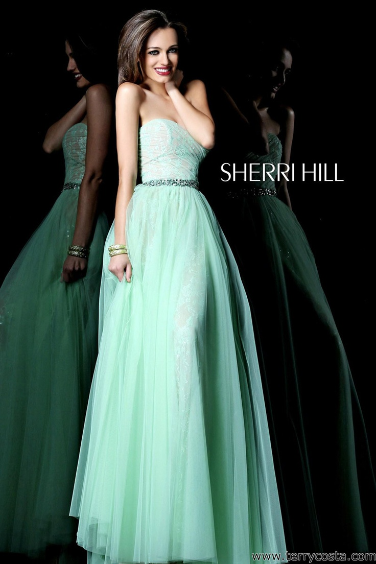 Sherri Hill 1579 on @Terry Costa - Delicate lace peeks through from under tulle in this lovely ball gown style prom dress for 2013.