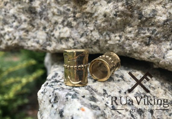 Brokk - Viking beard ring Made of bronze  Not heavy - 4 g  Size: 13,5mm x 10mm / 0.54 x 0.4 in Inner diameter: 7mm   The model was completely hand carved by me. The bead is made in traditional lost wax method.   Please allow small imperfections as each of them is the proof that your item is hand made by me.  ✩ ✩ ✩ ✩ ✩  Visit RUaViking on FB, where you can see snapshots from my workshop: https://www.facebook.com/ruaviking/  ✩ ✩ ✩ ✩ ✩