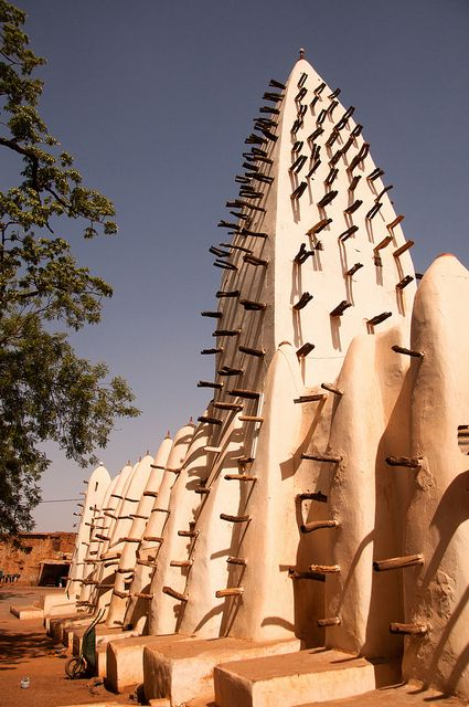 The Bobo-Dioulasso Mud Mosque, Burkina Faso.    The amazing Mosque in Bobo Burkina Faso. Built using mud and tree trunks the later of which are replaced every few years. They stick out so people can climb them making it easier to reach the top ones. Photo and Description by Gavin Chapman