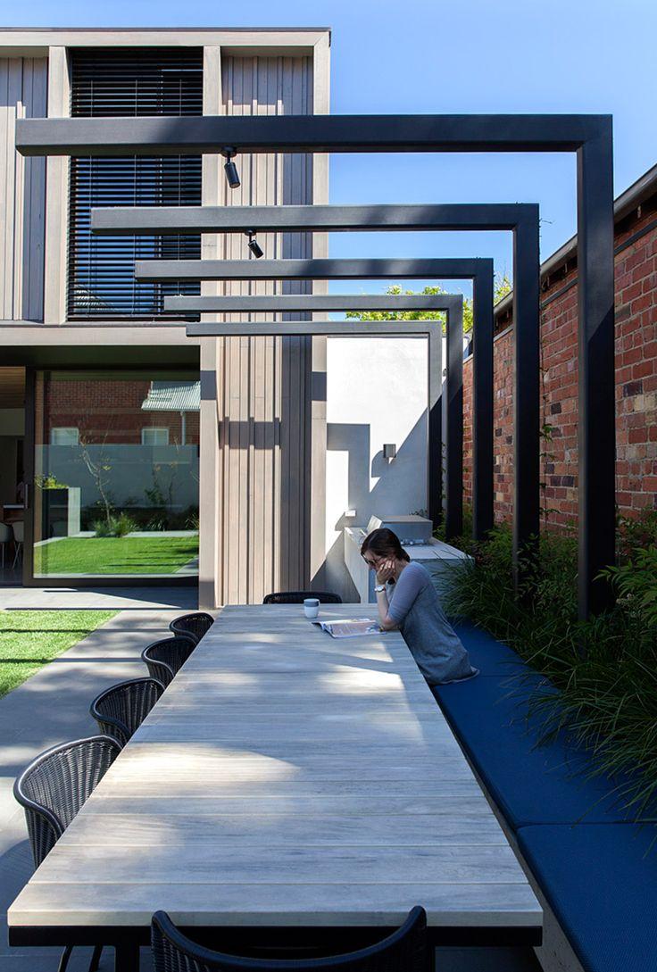 garden. modern steel pergola.  built in seating as gardenbed edge