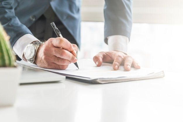 Close Up Of Businessman Writing On Document With Pen On Desk Business Man Successful Business Man Success Business