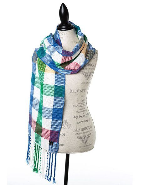 Hand woven in Canada with a soft 100% merino these scarves turn a practical wardrobe accessory into a fashion statement. The scarves are in a checkerboard pattern with colours that Cindy Goble has chosen to represent the natural Canadian landscape – coastal shores, wheat fields, mountain peaks and snowy tundra. (Arctic White in Photo) @Goble
