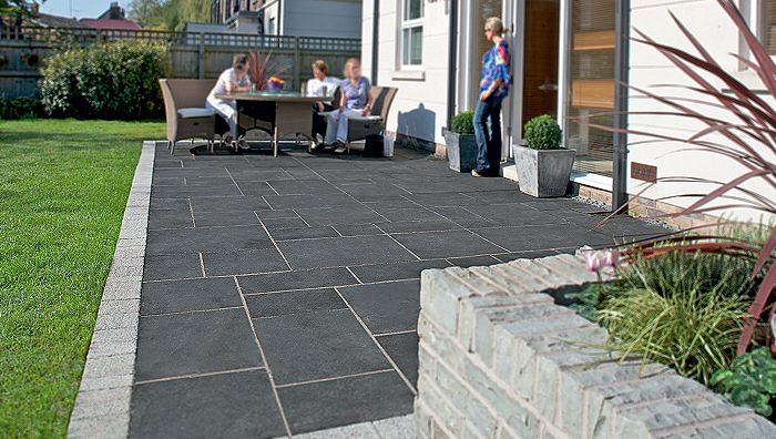 Edge Detail. Fairstone Limestone Riven Garden Paving - Charcoal