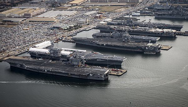 The aircraft carriers USS Dwight D. Eisenhower (CVN 69), USS George H.W. Bush (CVN 77), USS Enterprise (CVN 65), USS Harry S. Truman (CVN 75), and USS Abraham Lincoln (CVN 72) are in port at Naval Station Norfolk, Va. US Navy Photo..AND ALL IN A ROW????