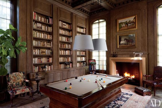 Masculine surroundings, damn, a pool table should not be relegated to a corner of the basement, but rather showcased in a cozy game room that is stylish as well as functional. Whether you're looking for a traditional setting—with wood paneling and built-in bookcases—or a modern, minimalist space with clean lines, these billiard rooms from the AD archives spotlight the game in inspiring ways with eye-catching light fixtures, striking artworks, chic bars, or crackling fireplaces.
