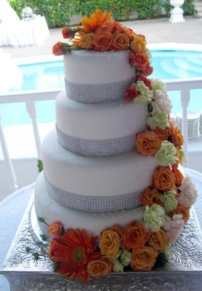 Wedding Cakes: Drape of orange and red flower wedding cake