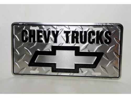 For Sale if still available: New Chevy trucks aluminum novelty license plate sign or wall hanging.  Punched holes in corners for easy mounting or hanging