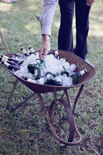 Drinks & Ice in Vintage Wheelbarrows for guests! #wedding #wheelbarrow #rustic #vintage #drinks
