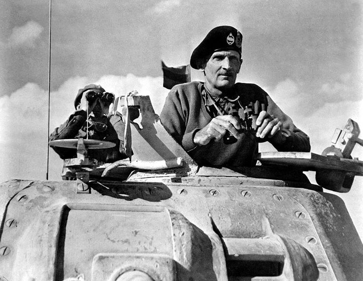 North African Campaign - General Bernard L. Montgomery watches his tanks move up, 1942.