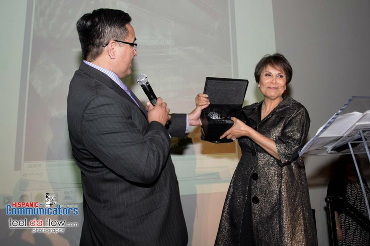 Gloria Campos recieves a beautiful crystal microphone award from the Hispanic Communicators after 30 years as a news anchor.