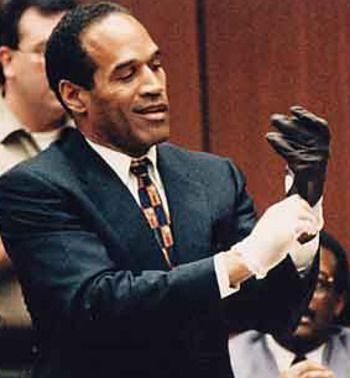 OJ Simpson trying on the gloves at his murder trial in 1995. With that smirk on his face....