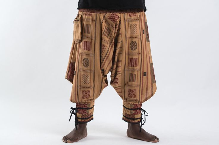 """Amazing Unique Harem Pants made from fairtrade beautiful traditional hill tribe fabric from the North of Thailand. With open-side legs and ankle cuffs with adjustable straps, you can move freely while practicing yoga, doing the split, or chasing butterflies in the mountains of Pai. Suitable for both men and women. Elastic waist on the back allows the pants to fit most sizes. Measurement:  Waist: 32"""" - 50"""" Hips: Up to 50"""" Total length: 37"""""""