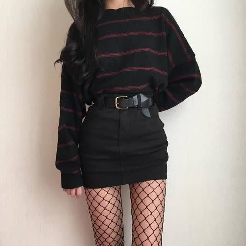 Jumper paired nicely with a gorgeous thick belt. Tucked into a classic grunge cut skirt with fishnet tights pairing the whole outfit together.  https://www.pinterest.co.uk/source/shopstyle.it/