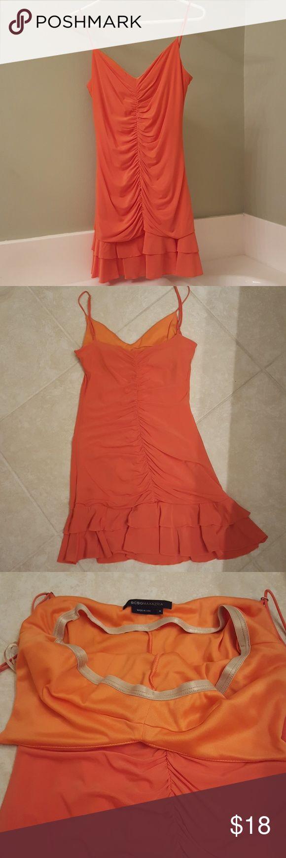 BCBGMaxAzria Orange Mini Dress BCBGMaxAzria Orange Mini Dress with very unnoticeable stain on back of dress skirt. See last picture. Price reflects the flaw. Offers welcome. BCBGMaxAzria Dresses Mini